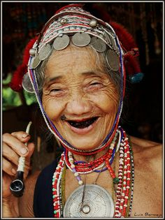 Love her smile!!  (could be me in another 40-50 years with better teeth, of course ...I believe I have those same coins & kuchi adornments from bellydance!!) Oh...and I'd like to know what she has in her pipe!! LMBO