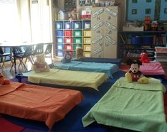 daycare idea for color coordinating things 4kids. There dishes, bedding, wall hooks or cubbies for there items etc...