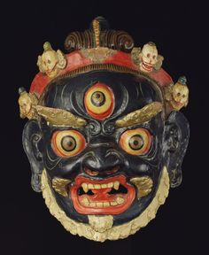 Mahakala is one of the most important wrathful protectors of Mongolian Buddhism. Crowned with a diadem of 5 skulls, a snake winds around his topknot. Fierce arrow-like eyebrows accentuate  3 red-rimmed bulging eyeballs.