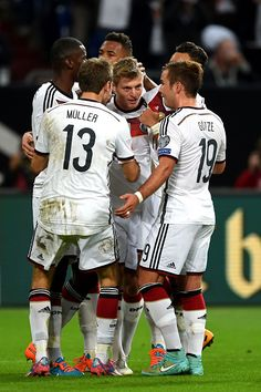 oni Kroos (C) of Germany is congratulated by teammates after scoring the opening goal during the EURO 2016 Qualifier between Germany and Republic of Ireland at the Veltins-Arena on October 14, 2014 in Gelsenkirchen, Germany