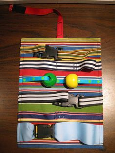 homemade toy - clips, velcro, ribbon, beads-wish I could sew! Great small motor activity.