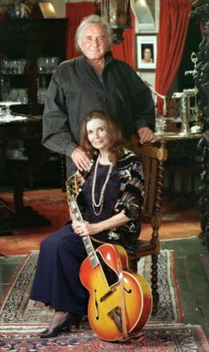 """Country music legend Johnny Cash is shown with his wife, June Carter Cash, in their Hendersonville, Tenn. home in 1999. Johnny Cash, known as  """"The Man in Black"""" and famous for songs like """"I Walk the Line,"""" """"Ring of Fire"""" and """"A Boy Named Sue,"""" died Friday, Sept. 12, 2003 from complications from diabetes in Nashville, Tenn. June Carter Cash died May 15, 2003."""