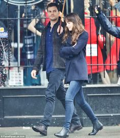 And action: Dakota and Jamie were strolling around the city's Gastown District for filming...