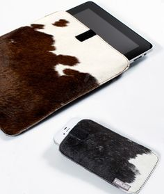 Cowhide covers ~ I bet Becci could make these for us!