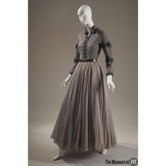 Set People and Brands: Brand: Balmain French, founded 1945  Medium: Grey wool knit, grey silk chiffon, metallic leather and beading Date: c.1952 Country: France Credit: Gift of Mrs. F. Leval