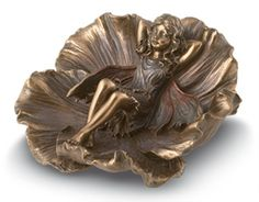 """Fairy in Petals GaelSong Exclusive! Ahh, this is the life! A tiny fairy snuggles down for a bit of shut-eye nestled in the petals of an accommodating flower. Bronze-finished resin with hand-painted tints. 4"""" across."""