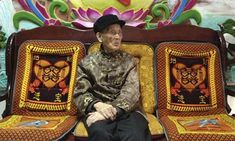 Huang Puxin, who says he is 113, waits for visitors at his home in Longevity Village in Bama, Guangxi. Photograph: Tania Branigan for the Gu...