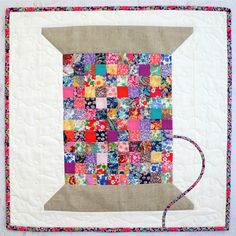 Liberty Vintage Cotton Reel Mini Quilt pattern. By Jemima Flendt, Tied with a…