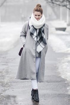 fall / winter - street style - street chic style - winter outfits - casual outfits - grey coat + black and white plaid scarf + white infinity scarf + grey chunky knit sweater + white skinny jeans + black heeled booties + burgundy shoulder bag