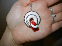 White Tentacle Holding an Anatomical Heart by KrakenFashion, $25.00