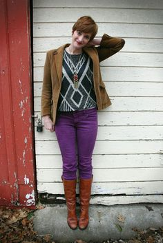purple pants, cognac boots, brown/tan cardigan, black and white print top, long necklace