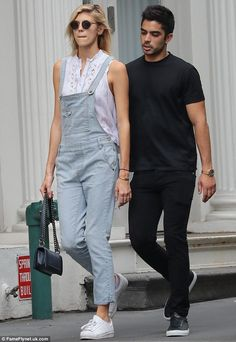 Close: Devon Windsor, 22, looked trendy in stripped dungarees as she strolled hand in hand...
