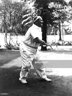 Nazi leader Hermann Goering (1893 - 1946) plays tennis in the garden of his villa, Carinhall, Prussia, June 4, 1936.
