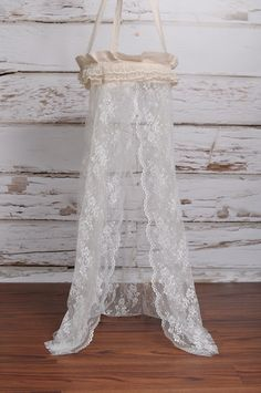 use lace curtain as prop.... with bed maybe?