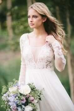 Bride in a Long Sleeve Wedding Dress // Photography ~ White Images