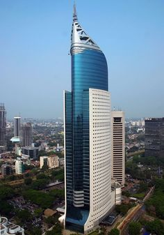 """bautyofworld:"""" Wisma Indonesia Wisma 46 is a 262 m tall (architectural height) skyscraper located in the Kota BNI-Maybank complex at Jalan Jenderal Sudirman in Central Jakarta, Indonesia. The 48 storey office tower was completed in 1996 under. Tower Building, Building Facade, Building Structure, Building Design, Modern Architecture Design, Facade Design, Futuristic Architecture, Amazing Architecture, Amazing Buildings"""