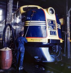 Santa Fe Diesel: March 1943. Washing one of the Santa Fe R.R. 5,400-horsepower diesel freight locomotives in the roundhouse at Argentine, Kansas