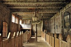 Inside Kvernes stave church (built around 1400) . The ship hanging from the rafter is 300 years old. As Norway is a seafaring nation, it is an old tradition to hang a ship in her churches.