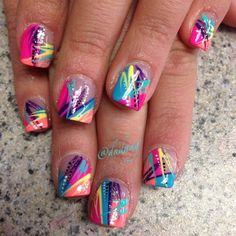 Paint splatter inspired abstract nail art design. If you can't decide just which color to use, then why not use the classic paint splatter technique and combine all your favorite colors into one design.