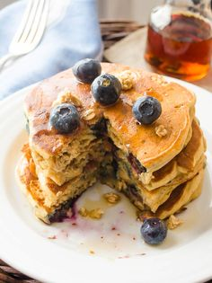 Blueberry Granola Crunch Pancakes are the fluffiest buttermilk pancakes from the cookbook Stack Happy!