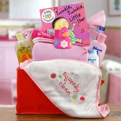 Splash splash, it's time for baby girl to take a bath. This basket is filled with Johnson & Johnson products and other goodies. Perfect for a baby shower or