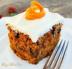 The Best Carrot Cake EVER with Cream Cheese Frosting! Moist, delicious and full of carrots and walnuts, the cinnamon gives it a warm spicy flavor. The cream cheese frosting makes it decadent!