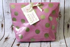 Never buy pre-made gift bags again! Learn how to make a gift bag from wrapping paper. It's easy and PERFECT for oddly shaped items!