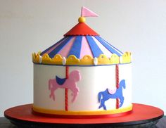 Carousel cake with silhouette horses