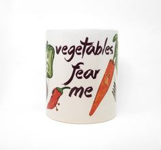 Vegetables Fear Me! I will eat them all!  This design was hand-drawn with colored pencils and digitally edited before being printed and permanently pressed with dye-sublimation into a nice ceramic 11oz mug in my Spokane, WA home studio.