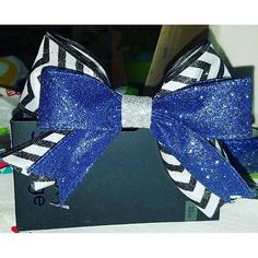 Cheer bows are slowly taking over my life. Or is that the glitter quickly taking over my life?  #hairbows #cheerleader #cheerbows #cheerbowsforsale #getthemwhiletheyrehot #etsy #etsyseller #dazzleanddreams #etsyshop #etsysellersofinstagram #etsyhandmade #
