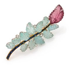 ILARIO 1970S ORIGINAL PIN foliage She is a curvy pin adorned with aquamarines and tourmalines sheets engraved roses dotted with brilliant cut diamonds in crimp. The enhanced rod calibrated sapphires. 18K gold mount.