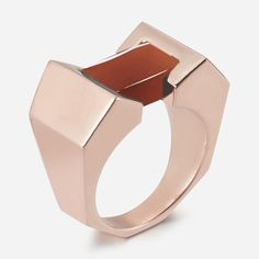 Building Block: W. Britt Big Block Ring.  A STONE PRISM BALANCES IN THE CENTER OF THIS ANGULAR STATEMENT RING.