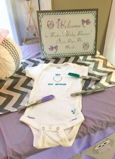 Sign the onesie at an owl baby shower party! See more party planning ideas at CatchMyParty.com!