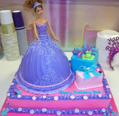 "This is the cake I made for my niece. It is a real barbie, I used the wonder mold pan and ann 8"" cake underneath. My niece wanted to keep the doll cake for after the party so I put it in a cake plate that was easy to take off when we cut the cake. The frog and bows are MMF/gumpaste 50/50 mix. She decided she wanted a frog on it a couple of days before the party so this is what I came up with. Thanks for looking"
