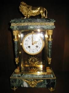 Green marble lion clock.