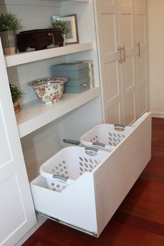 Pull-out drawer for laundry baskets (http://megandmartinmen.blogspot.com/2013/01/ikea-pax-wardrobe-hack.html)