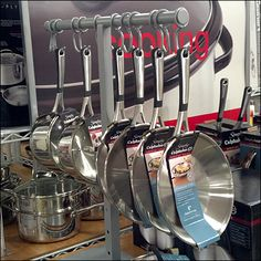 This T-Stand Cookware Hang Rod is an open and airy yet in-your-face cookware display. And with grey (a neutral) ranked as the least visible color, even. Exhibition Booth Design, Exhibition Stands, Exhibit Design, Print Advertising, Advertising Campaign, Print Ads, Kitchen Supply Store, Retail Fixtures, Kitchen Dishes