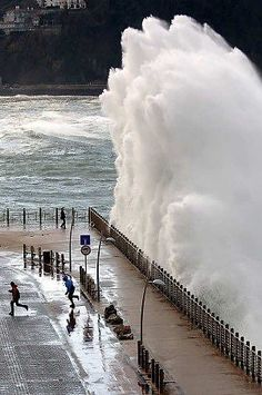 Majestic wave hitting the posh sea resort of elegant San Sebastian, Spain, Basque Country