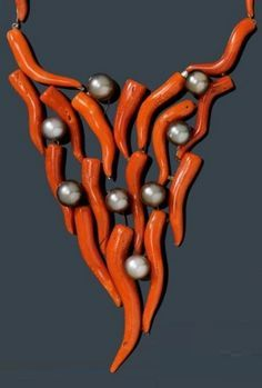 """CORAL AND PEARL NECKLACE, ca. Very fancy necklace, the """"V""""-shaped top of 24 dark red coral branchlets and 8 grey Tahiti cultured pearls of ca. Ethnic Jewelry, Coral Jewelry, Unusual Jewelry, Modern Jewelry, Statement Jewelry, Antique Jewelry, Beaded Jewelry, Vintage Jewelry, Handmade Jewelry"""