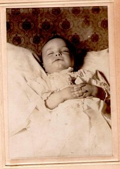 Post mortem, 1880's.  This baby looks like he (or she) is smiling in his (or her) sleep.  What a nice photo for remembrance!