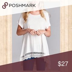 Ivory lace hem tee Not your basic tee!! Ivory top features hi-low hem and lace detail around bottom. Tops
