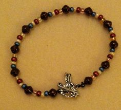 Beaded bracelet with dragonfly clasp
