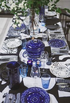 Tiina Laakonen's Midsummer table for Remodelista (her whole house is black&white&blue)