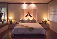 romantic room- Love the Dim lights over the bed