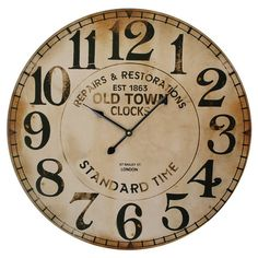 "Antiqued wall clock. Product: Wall clock    Construction Material: MDF   Color: Weathered black and ivory  Accommodates: AA Batteries - not included         Dimensions: 23"" Diameter"