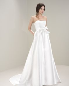 A tailored satin gown by Jesus Peiro 7040. So elegant yet cute.