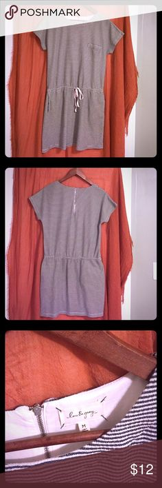 Lou & Grey casual dress Such a sweet little summer item from Lou & Grey (LOFT). Drop waist with tie. Three pockets: two side/hip and one left chest. 6.5 inch zipper on back neckline for easy slip-on. Has the look and feel of the 1920s. Think of all those summer garden parties! 🌸🥂80% cotton, 20% polyester- means easy care. (Stripes are actually charcoal gray; photo make it look navy.) Bundle option available. Lou & Grey Dresses