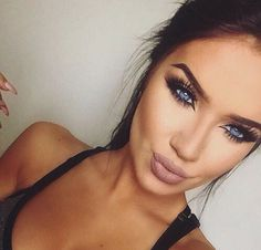 Huge lashes, contoured cheekbones & matte, nude lip. Simple, daytime makeup.