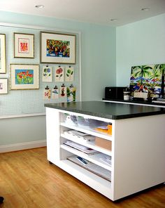 Art Studio/ Home Office design with custom island and 5' x 8' pegboard