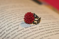 Cabochon resin mum ring. A different flower but still gorgeous. I also bought one of these and love it!!